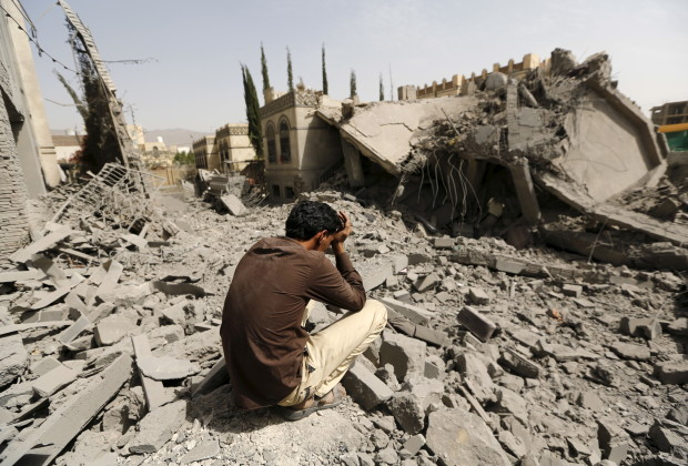 A guard sits on the rubble of the house of Brigadier Fouad al-Emad, an army commander loyal to the Houthis, after air strikes destroyed it in Sanaa, Yemen June 15, 2015. Warplanes from a Saudi-led coalition bombarded Yemens Houthi-controlled capital Sanaa overnight as the countrys warring factions prepared for talks expected to start in Geneva on Monday. REUTERS/Khaled Abdullah      TPX IMAGES OF THE DAY      - RTX1GJK0