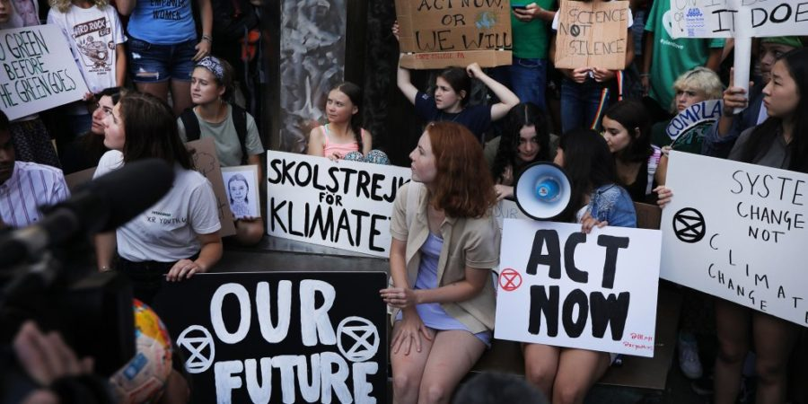 NEW YORK, NEW YORK - AUGUST 30: Swedish climate activist Greta Thunberg, 16, attends a youth led protest in front of the United Nations (UN) in support of measures to stop climate change on on August 30, 2019 in New York City. Thunberg joined dozens of other youths in the protest and march which demanded that politicians and others in power do more to halt a warming planet. Thunberg arrived into New York City on Wednesday aboard a sailboat after traveling across the Atlantic for 13 days to make a point about carbon footprints and global travel. The young activist will address a UN conference on climate change while in New York. (Photo by Spencer Platt/Getty Images)