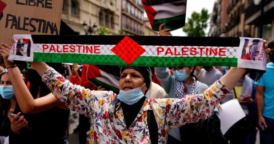 A woman participates in a protest in support of Palestinians amid their ongoing conflict with Israel, in Madrid, Spain May 15, 2021. REUTERS/Juan Medina