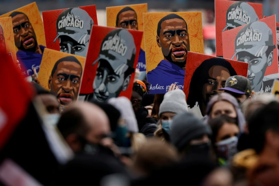 People hold placards with paintings of George Floyd, Daunte Wright and Philando Castile after the verdict in the trial of former Minneapolis police officer Derek Chauvin, found guilty of the death of George Floyd, in front of Hennepin County Government Center, in Minneapolis, Minnesota, U.S., April 20, 2021. REUTERS/Carlos Barria